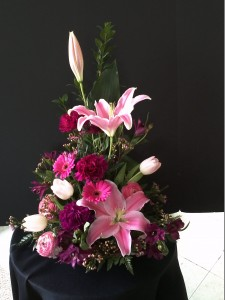 Funeral Flowers pink lilies in artistic arrgmt with mixed lavender & puple flowers